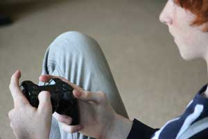 11 Signs of Video Game Disorder | Electronic addicted teen playing video games