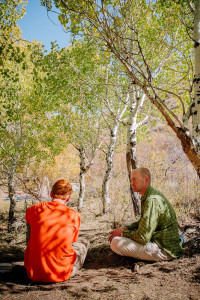 Therapist and teen session in wilderness