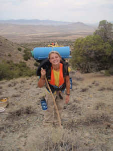 Girl with pack and hiking stick in the wilderness at Outback therapeutic expeditions