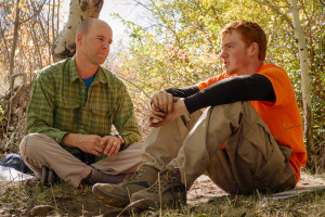 Therapist and teen in therapy session in the desert