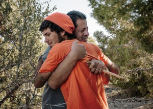 Father and son emotionally embracing at Outback Therapeutic Expeditions