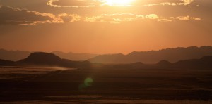 Desert setting with a yellow haze and a high sun at Outback Therapeutic Expeditions