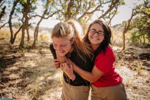 Two teen girls playing around Outback Therapeutic Expeditions
