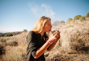 Wilderness teen blowing a coal into flame at Outback Therapeutic Expeditions