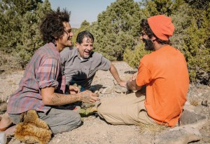 Dad and sons painting faces with ochre during Family expedition at Outback Therapeutic Expeditions