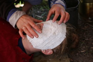 Girl making face mask with plaster