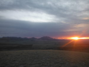 Sunset in the wilderness with gray clouds