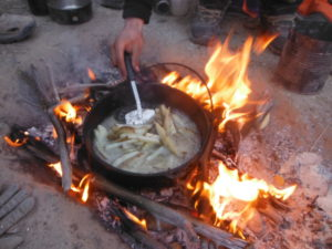 Making french fries in the wilderness in a dutch oven